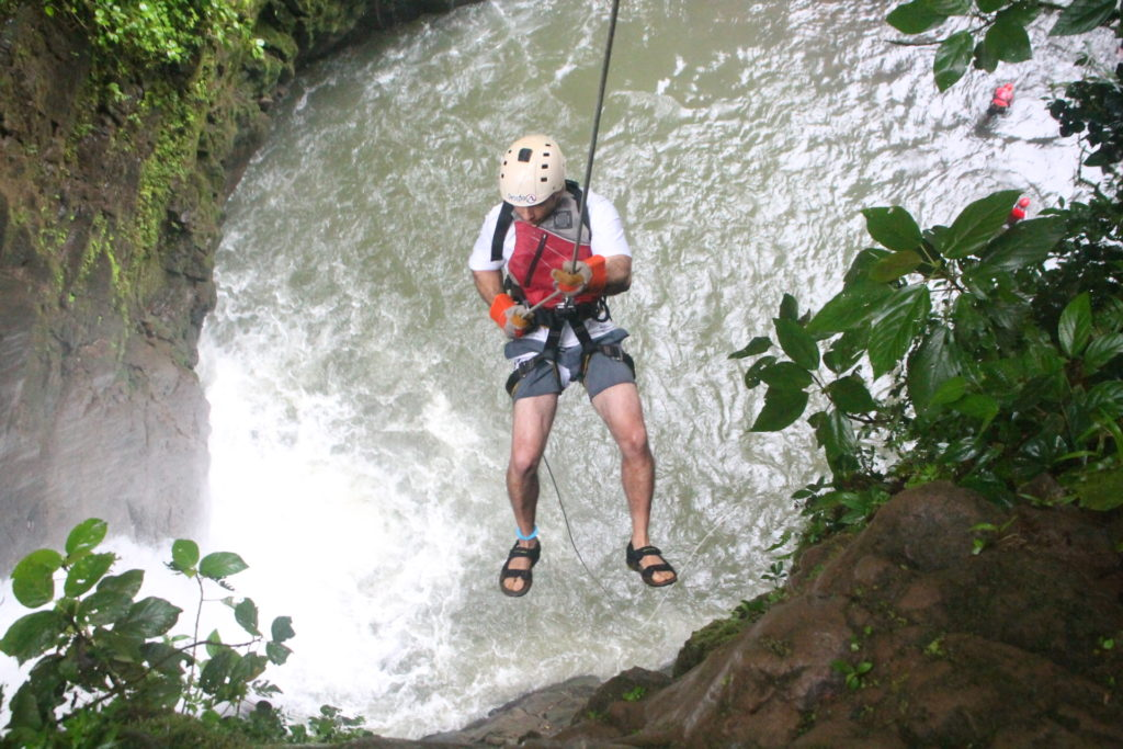 Rappel Down a Cliff Next to Waterfall